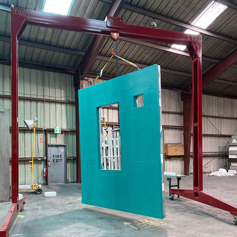 Ironco Enterprises I-Lift crane hoisting a pre-fab building panel